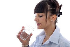 Young woman drinks a glass of water, on white Stock Image