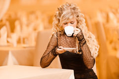Young woman drinks tea. Stock Photography