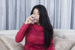 Young woman drinks water in a glass Royalty Free Stock Photo