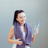 Young woman drinks water Royalty Free Stock Photography