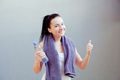 Young woman drinks water Royalty Free Stock Photos