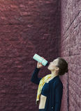 Young woman drinks water after training Royalty Free Stock Images