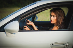 Young woman drive car Stock Images