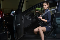 Young woman driver in her car with safety belt Stock Photos