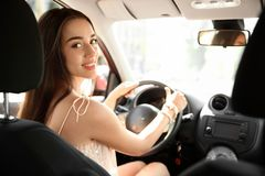 Young woman on driver`s seat royalty free stock images
