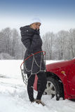 Young woman driver with tyre chains Stock Image