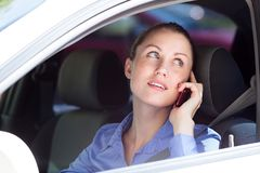Woman driver using a mobile telephone Royalty Free Stock Images