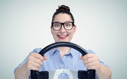 Young woman driver wearing glasses with steering wheel, auto concept.  royalty free stock photo