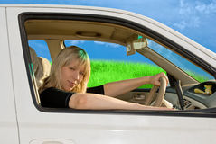 Young woman driving Stock Photo