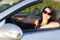 Young woman driving Stock Images