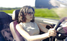 Young woman is driving Royalty Free Stock Photos
