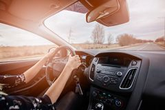 Young woman driving a car. Royalty Free Stock Photo