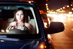 Young woman driving car. Young asian woman driving car in the night city Royalty Free Stock Photos