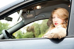 Young woman  driving a car Royalty Free Stock Photography