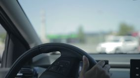 Young woman driving the car stock footage