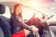 Young woman driving car. Fast delivery background Royalty Free Stock Photo