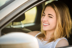 Young woman driving car Stock Image