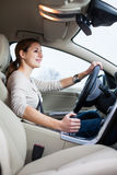 Young, woman driving a car Stock Photography