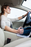 Young, woman driving a car Stock Images