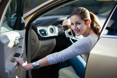 Young, woman driving a car Royalty Free Stock Photos