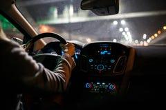 Young woman driving a car at night Royalty Free Stock Photos