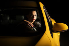 Young woman driving a car in the night Royalty Free Stock Image