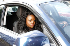 Young woman driving a car waiting in traffic Stock Image