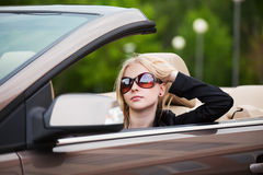 Young fashion woman driving a convertible car Stock Photography