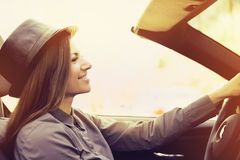Young woman driving a convertible car royalty free stock photo
