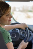 Young woman driving her car. Young woman driving her new car Royalty Free Stock Photos