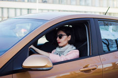Young woman driving her car Stock Photos