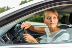 Young woman driving her car Stock Photography