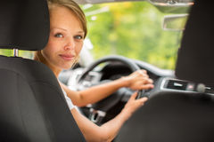 Young woman driving her car Stock Photo