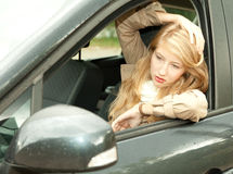 Young woman driving her new car Stock Images