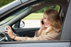 Young woman driving her new car Stock Photography
