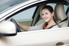 Young woman driving her new car Stock Photos