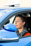 Young woman at driving lesson Stock Photography