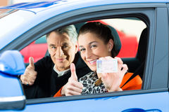 Young woman at driving lesson royalty free stock photo
