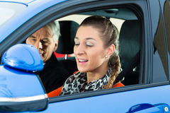 Young woman at driving lesson royalty free stock photography