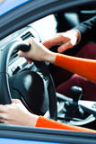 Young woman at driving lesson royalty free stock images