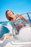 Young woman driving a motor boat Royalty Free Stock Photography