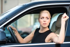 Young woman driving new car Royalty Free Stock Photo