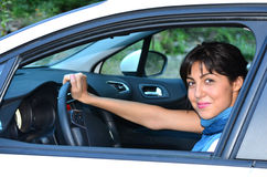 Young woman driving new car Stock Photography