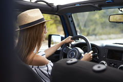 Young Woman Driving Open Top Car On Country Road Royalty Free Stock Images