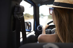 Young Woman Driving Open Top Car On Country Road Royalty Free Stock Image