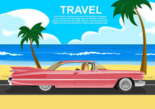 Young woman driving a retro car along the sea coast. Young woman driving a pink retro car along the sea coast Royalty Free Stock Image