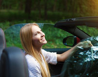 Young woman driving a sports car Stock Photography
