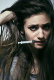 Young woman drug addict. Young depressed woman drug addict close up royalty free stock photo
