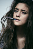 Young woman drug addict. Young depressed woman drug addict close up stock images