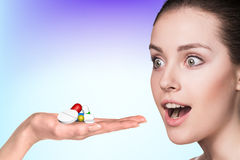 Young woman and drug capsules in hand Royalty Free Stock Photos